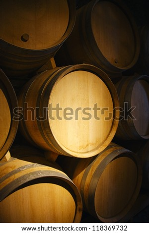 Wine barrels in a old wine cellar - stock photo