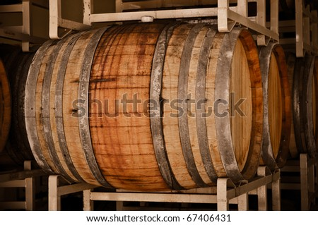 Wine Barrels in Cellar - stock photo