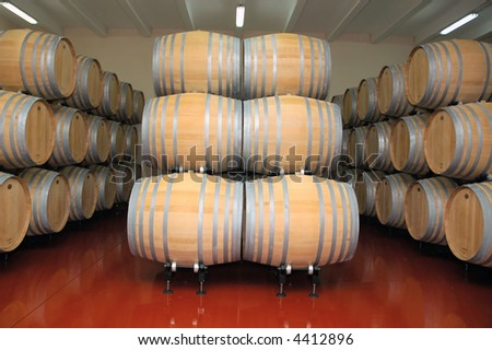 Wine barrels in winery. - stock photo