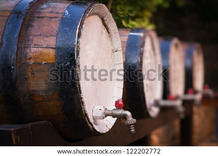 Wine barrels on the stand - stock photo