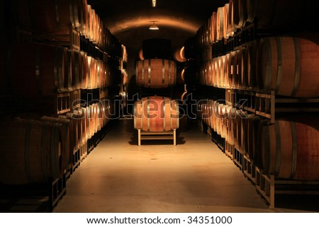 Wine barrels stacked in a cellar. Also available in vertical. - stock photo