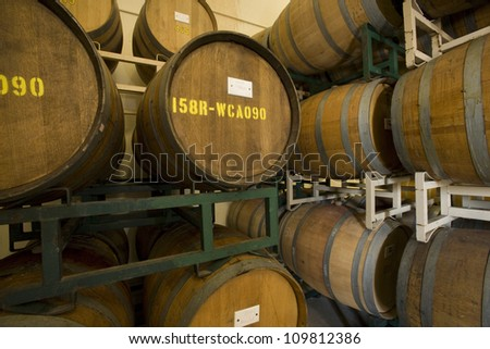 Wine barrels stored in an old cellar of the winery