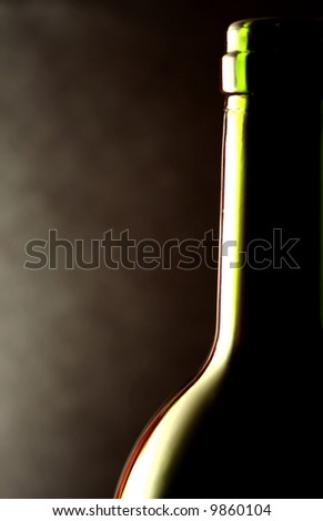 wine bottle against a black background - stock photo