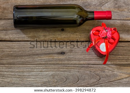 wine bottle and box gifts on  wooden. - stock photo