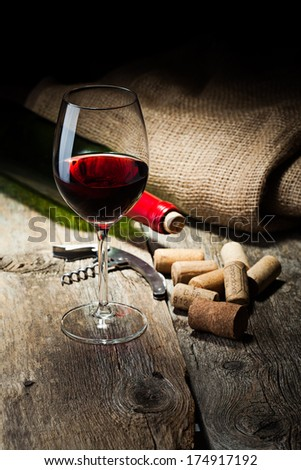 wine bottle and cork and glass with red wine - stock photo