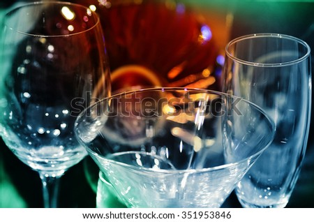 Wine bottle and glasses. Tinted image. Low depth of field  - stock photo