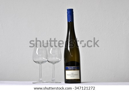 wine bottle with glasses - stock photo