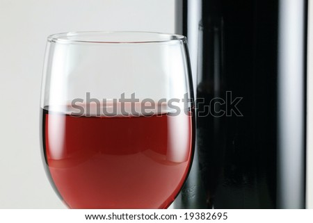 Wine Bottle with Red Wine Glass on White Background