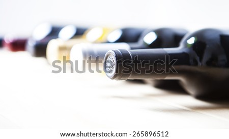 Wine bottles in a row isolated on a white background  - stock photo