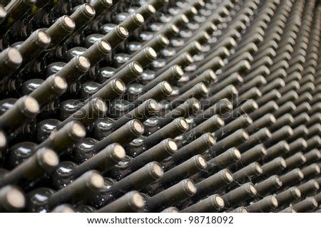 wine bottles in wine cellar - stock photo