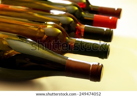 Wine bottles lying in row close-up
