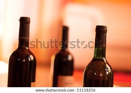 Wine bottles, shallow DoF - stock photo