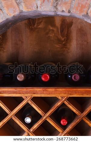 Wine bottles stored in a shelves - stock photo