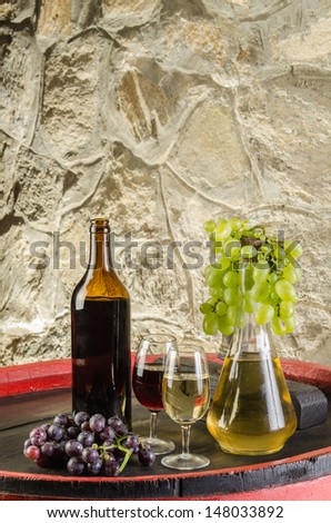 Wine bottles, wine glasses and grapes - stock photo
