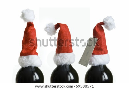 Wine bottles with Santa hat - stock photo