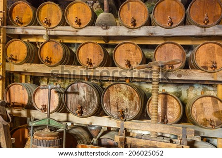 Wine cellar fully loaded with barrels and tools in Great Meteoro Monastery in Greece - stock photo