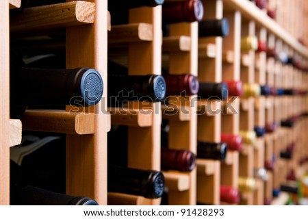 Wine Cellar with Stacks of Bottles - stock photo