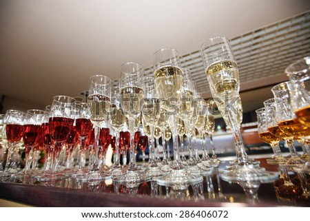 wine, champagne, cognac glasses on wedding reception - stock photo