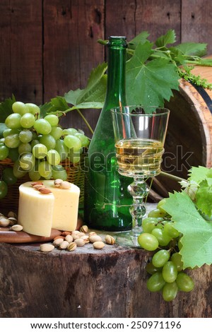 Wine, cheese and grapes  - stock photo