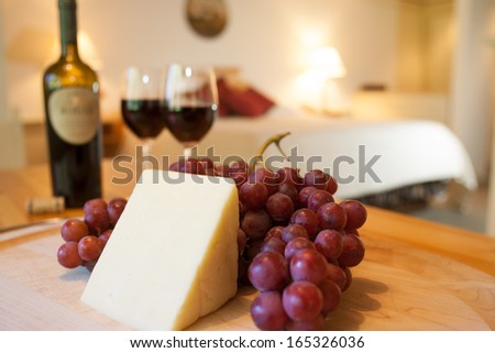 Wine, cheese and grapes for a snack in a luxurious hotel room, Stowe, Vermont, USA - stock photo