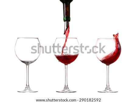 Wine collection - Splashing red wine in a glass. Isolated on white background and pourer - stock photo