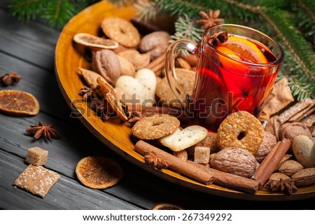 Wine. Cookies in the shape of stars, spices and mulled wine on a plate, horizontal - stock photo