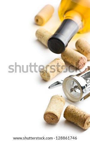 wine cork, corkscrew and bottle of white wine on white background