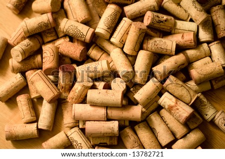 wine corks heap on wooden background - stock photo