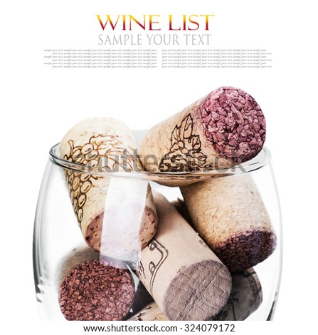 Wine corks in glass isolated on white background. Focus on wine corks. text example - stock photo