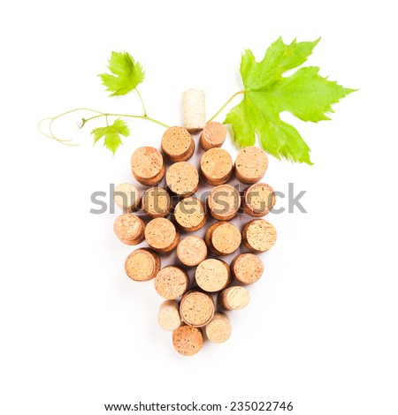 Wine corks isolated on white in grape shape with green leaf - stock photo
