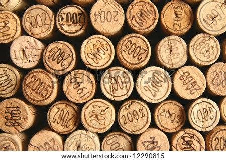Wine corks tops with dates. May serve as a background
