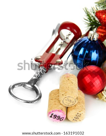 Wine corks with new Year toys isolated on white - stock photo