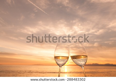 Wine glass and dusk of beach