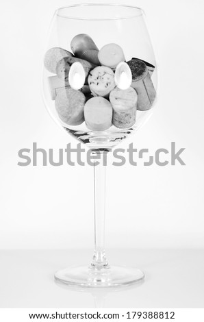 Wine glass filled in by wine corks, Black&White - stock photo