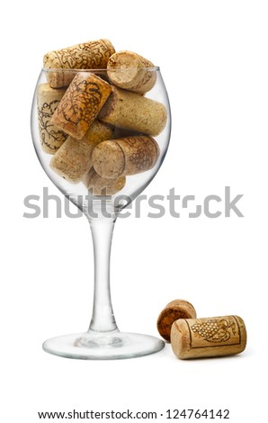 Wine glass filled with bottle corks isolated on white - stock photo