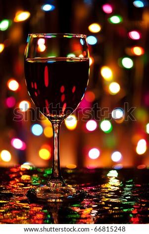 Wine glass in front of defocused lights - stock photo