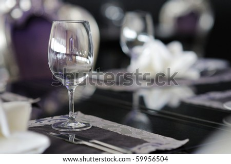 Wine glass on a table decorated for an event celebration