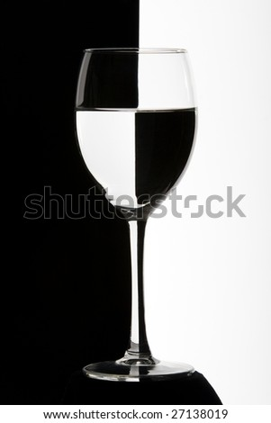 Wine glass on black and white backlight