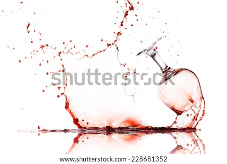 Wine Glass Spilling Contents - stock photo