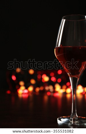 Wine glass with bokeh on dark background