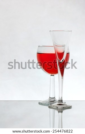Wine glass with red liquid