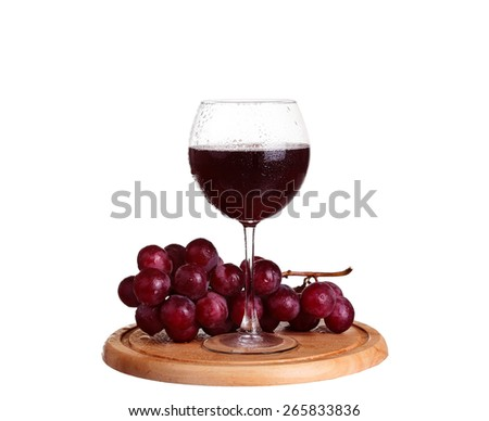wine glass with red wine, wineglass of wine and grapes on board isolated over white background - stock photo
