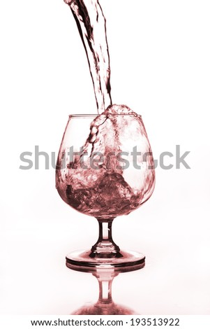 wine glass with water pouring