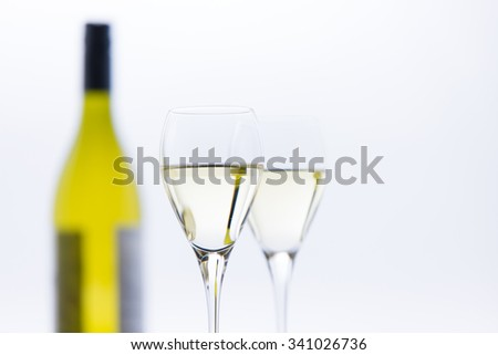 Wine glasses and a bottle on the table