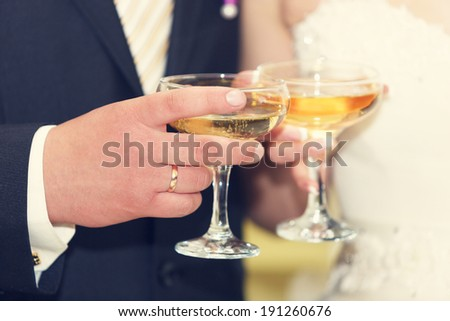wine glasses in hand bride and groom.