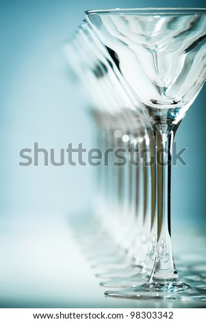 Wine glasses in row. Blue background. - stock photo