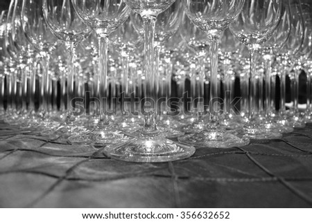 Wine glasses in row on table - stock photo