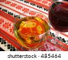 wine glasses on a patterned table-cloth - stock photo