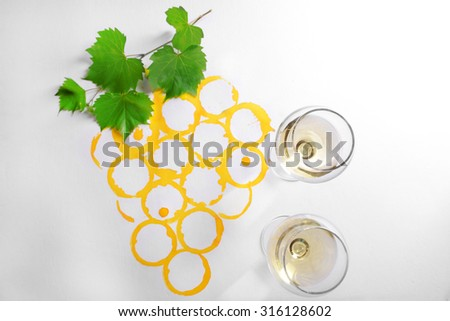 Wine glasses on picture painted with wine - stock photo