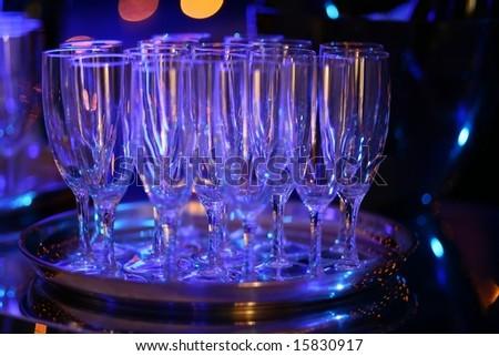 wine glasses on tray on night club bar - stock photo